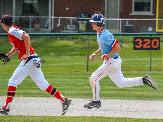 Running out a double in the district final is Livonia