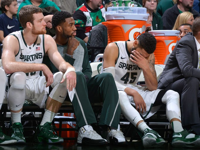 Spartan Denzel Valentine(right) covers his face in