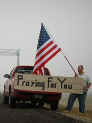 Mark Rodgers shows his support Nov. 8, 2009, near the front gate to Fort Hood  after Army Maj. Nidal Hasan killed 13 and wounded 30 others.