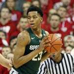 Deyonta Davis works to move the ball around Wisconsin Badgers forward Alex Illikainen (25) at the Kohl Center. Wisconsin defeated Michigan State 77-76.