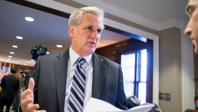 """Majority Leader Kevin McCarthy, R-Calif., speaks with a reporter following a closed-door GOP caucus meeting  at the Republican National Headquarters on Capitol Hill in Washington, Tuesday, Dec. 8, 2015. Invoking the Paris terror attacks, House lawmakers pushed toward a vote Tuesday on legislation tightening controls on travel to the U.S. and requiring visas for anyone who's been in Iraq or Syria in the previous five years. """"You have more than 5,000 individuals that have Western passports in this program that have gone to Iraq or Syria in the last five years,"""" said McCarthy. """"Those are gaps that we need to fix.""""  (AP Photo/J. Scott Applewhite)"""