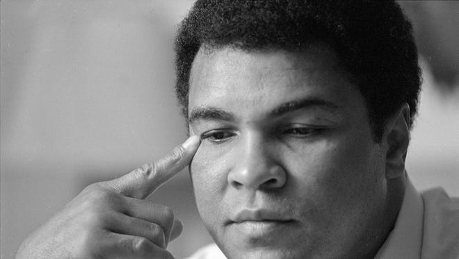 Muhammad Ali pauses to reflect at the Eagles Ballroom in Milwaukee on Nov. 11, 1983.