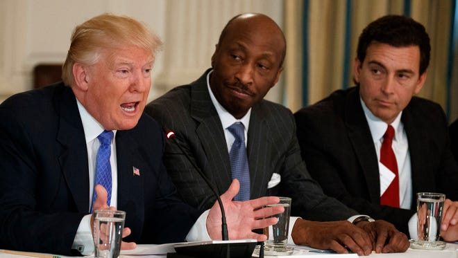 President Trump, left, speaks during a meeting with manufacturing executives on Feb. 23, 2017, at the White House  in Washington, including Merck CEO Kenneth Frazier, center, and Ford CEO Mark Fields. Frazier is resigning from the President's American Manufacturing Council citing 'a responsibility to take a stand against intolerance and extremism.' Frazier's resignation comes shortly after a violent confrontation between white supremacists and protesters in Charlottesville, Va.