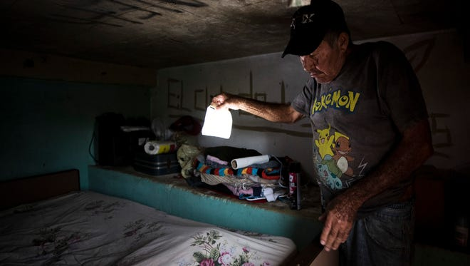 "Angel Rivera, 65, has been sleeping in the cellar underneath his home in the barrio La Loma in the Barranquitas municipality of Puerto Rico since Hurricane Maria. Rivera's home, like many of the homes in this mountainous area in the interior of the island, is mostly made of wood and suffered extensive damage during Hurricane Maria. ""I have moved most of my things down here,"" Rivera said. ""I have no roof on my home, so this is the only area that is free from rain."" Oct. 16, 2017"