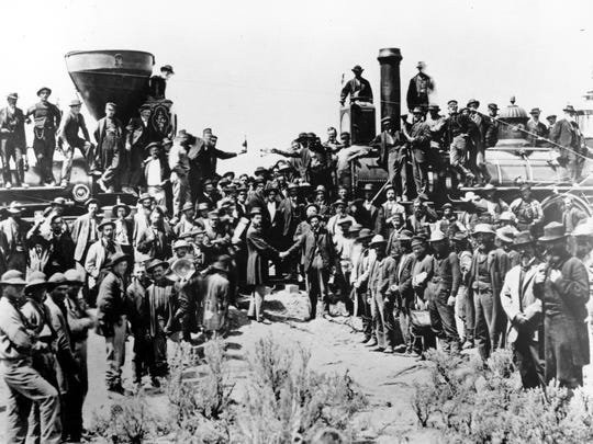 On May 10, 1869, in Promontory, Utah, workers celebrate completion of the first transcontinental railroad in the U.S. The Union Pacific's Locomotive No. 119, right, and Central Pacific's Jupiter edged forward over the golden spike that marked the joining of the nation by rail.