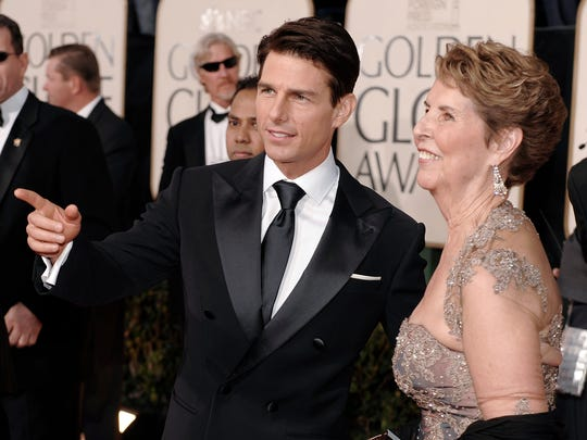 Actor Tom Cruise, center, and his mother  Mary Lee Mapother arrive at the 66th Annual Golden Globe Awards on Sunday, Jan. 11, 2009, in Beverly Hills, Calif. (AP Photo/Chris Pizzello)