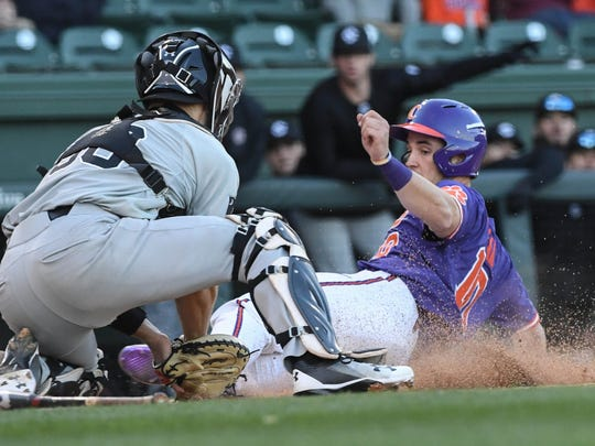Clemson sophomore catcher Kyle Wilkie (10) is tagged out at home by South Carolina junior Hunter Taylor during the bottom of the eighth inning on Saturday at Fluor Field in Greenville.