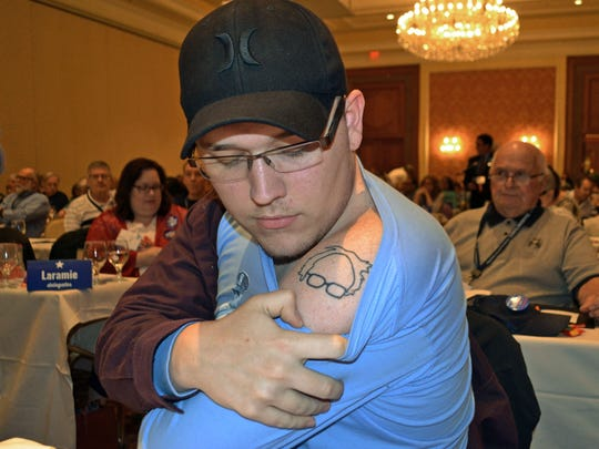 Kevin Phillips of Cheyenne, Wyo., shows off a Bernie Sanders tattoo at the Wyoming Democratic state party convention in Cheyenne in May 2016 in Cheyenne.