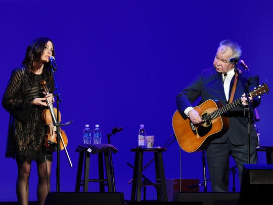 "Singers-songwriters Amanda Shires, left, and John Prine perform during the ""Love Letters: Thistle Farms Turns 20"" show at the Ryman Auditorium on May 3, 2017."