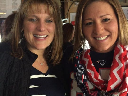 Sara Blanchard, left, of South Burlington and Heather Lefebvre of Milton smile as they speak about the New England Patriots and the AFC Championship on Sunday at The Pour House.