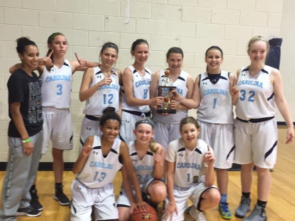 The Team Carolina - Asheville 14U girls basketball team.