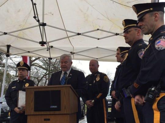 Bound Brook Mayor Bob Fazen reads a proclamation honoring retiring Police Chief Michael Jannone.