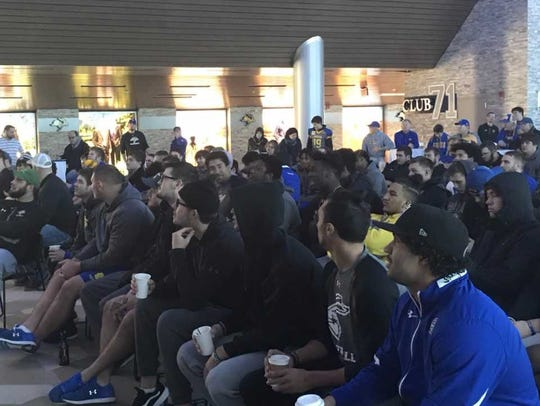 SDSU players watch the FCS selection show Sunday at