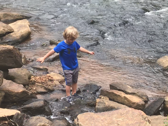 Graham Wedmore, 5, gets his feet wet in the Reedy River