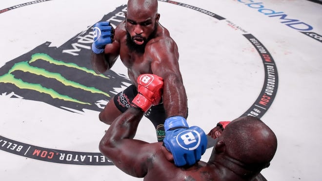 Former Rockton resident Corey Anderson gets set to unleash a punch on Melvin Manhoe Thursday during Anderson's Bellator MMA debut in Uncasville, Connecticut. Anderson won in a second-round TKO.