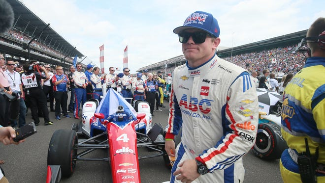 Conor Daly, who drives the No.4 ABC Supply Co. Chevrolet for A.J. Foyt Racing, walks to hug his mom before his race at the Indianapolis Motor Speedway for the Verizon IndyCar Series Sunday May 28, 2017.