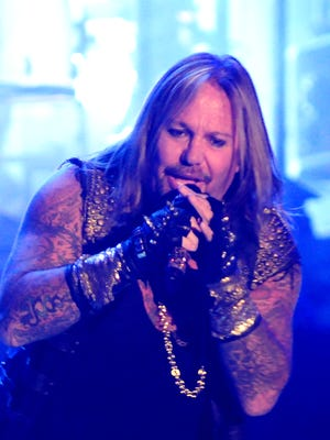 Vince Neil of Motley Crue performs The Final Tour show at the Resch Center, Tuesday, November 11, 2014.