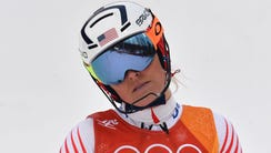 Lindsey Vonn reacts after missing a gate that would