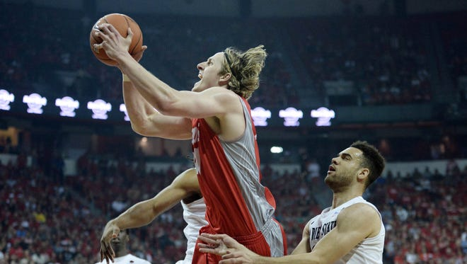 New Mexico Lobos forward Cameron Bairstow attempts a shot against San Diego State Aztecs forward JJ O'Brien in the first half at Thomas and Mack Center.