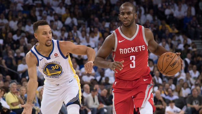 Houston Rockets guard Chris Paul (3) dribbles the basketball against Golden State Warriors guard Stephen Curry (30) during the second quarter at Oracle Arena.