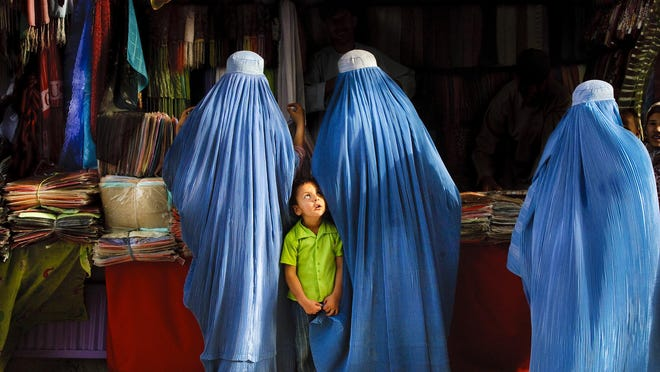 Alison Wright shot this image in 2007 in Mazar-E-Sharif, Afghanistan. The globe-trotting photographer is one of 60 professionals who will discuss their work and teach their craft during FOTOfusion Tuesday through Saturday in and around West Palm Beach.