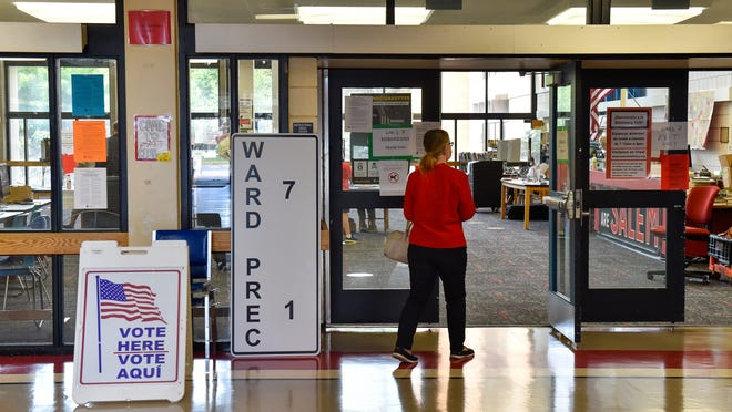 Residents in ward 7 precinct 1 cast their ballot in the state primary at Salem High School on Tuesday, Sept. 1, 2020.