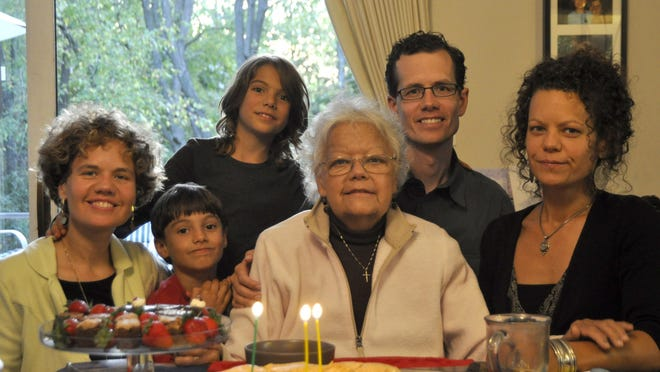 """The family of Sharon Bailey, 72, had a home funeral for her when she died in 2009. This is a photo of her last birthday, on Sept. 19, 2009. From left: daughter Beth Bailey Barbeau, grandson Marcellin Barbeau, 7 at the time, seated, grandson Jianmarco Barbeau, 9 at the time, Sharon Bailey, son Brian Bailey, and daughter Laura Bailey. """"I feel that my mom had a luxurious death,"""" said Beth Bailey Barbeau."""