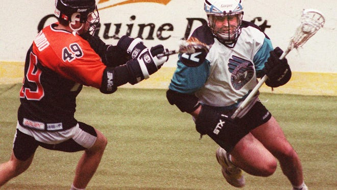 Paul Gait, right, scored four goals to help the Rochester Knighthawks win the 1997 championship.