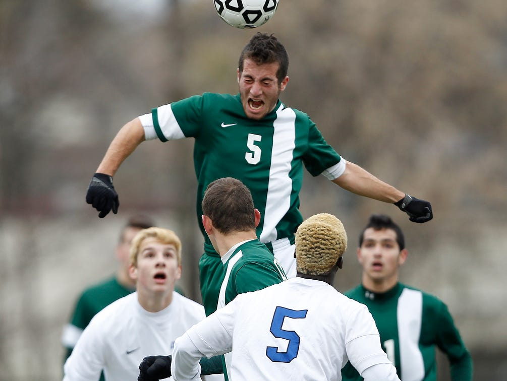 Solomon Schechter's Jacob Richman (5) goes up for a header during their 1-0 win over Geneseo in the NYSPHSAA Class C state semifinal soccer game at Middletown High School on Saturday, Nov. 14, 2015.