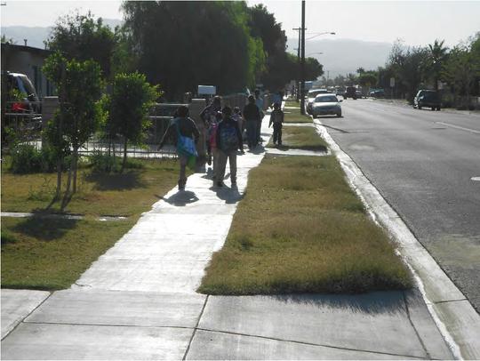School children using existing sidewalks along Kenner