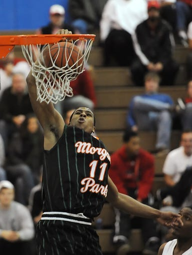 Wayne Blackshear (11) of Chicago Morgan Park dunks over Western on Saturday at the Play by Play Classic at Eastern High School.