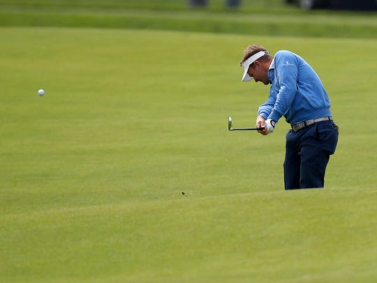 Billy Hurley III hits from the fairway of the eighth