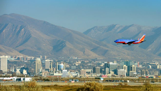 A jet prepares to land at Salt Lake International Airport on Nov. 25, 2013.