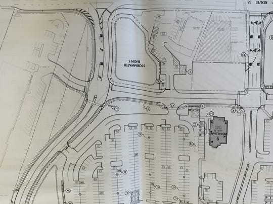 A photograph of plans showing the southern part of a proposed commercial town center in Middletown. These plans are up for final approval on June 1.