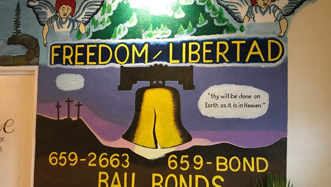 Sign inside the office of Freedom Libertad Bail Bond in San Angelo.