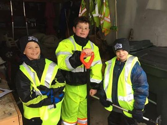 Josh and John Loudon, both 9, join the crew of Nicholas Danieli, right,, helping Morningside Road neighbors shovel their driveways and sidewalks in Verona.