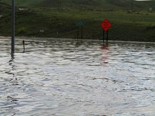 Heavy rain caused a flash flood in Shelby June 23 at the intersection of Interstate 15 and Highway 200.