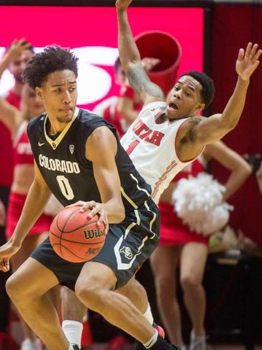 Colorado guard D'Shawn Schwartz (0) collides with Utah guard Justin Bibbins (1) during an NCAA college basketball game in Salt Lake City on Saturday, March 3, 2018. (Rick Egan/The Salt Lake Tribune via AP)