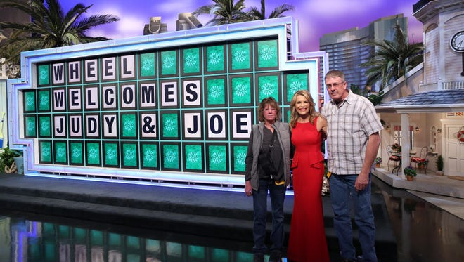 """Cascade residents Judy and Joe Voss meet with """"Wheel of Fortune"""" host Vanna White during a recent dream trip paid for by Cascade residents."""