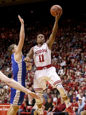 Nov 13, 2015; Bloomington, IN, USA; Indiana Hoosiers guard Yogi Ferrell (11) drives on Eastern Illinois Panthers guard Casey Teson (3) at Assembly Hall.