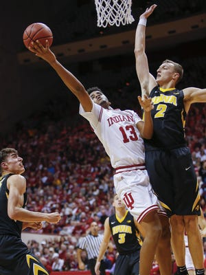 Indiana Hoosiers forward Juwan Morgan (13) shoots the ball against Iowa Hawkeyes forward Jack Nunge (2) at Assembly Hall on December 04, 2017 in Bloomington, Indiana. (Michael Hickey for The Star)