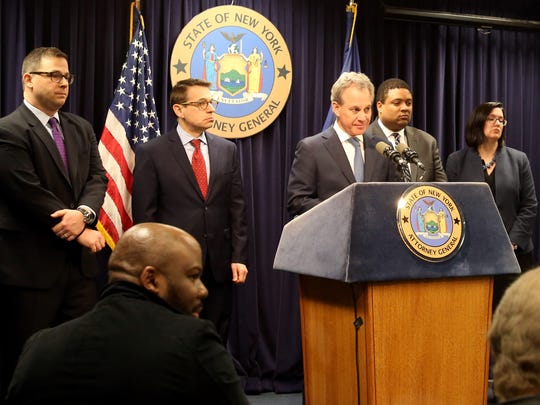 New York State Attorney General Eric T. Schneiderman, center, announces corruption charges against Mount Vernon Mayor Thomas during a press conference in Manhattan March 12, 2018.