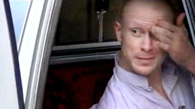 Sgt. Bowe Bergdahl sits in a vehicle guarded by the Taliban in eastern Afghanistan. He is scheduled to arrive at a military medical center in Texas on Friday.