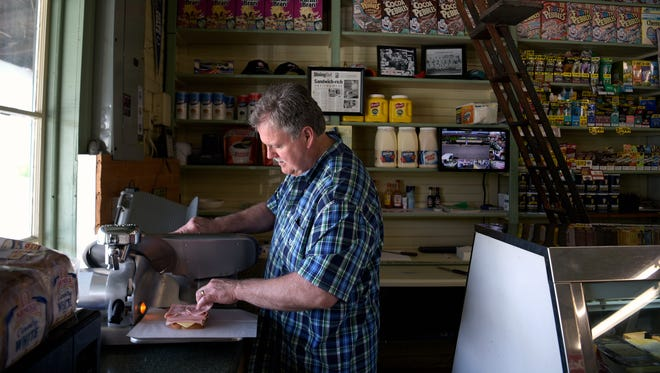 Charlie Huff of Huff's Grocery makes a sandwich at his general store in Burwood, Tenn. on Wednesday, April 5, 2017. The Huff family purchased the building in 1937. The two story building was built in 1911 and was listed on the National Register of Historic Places in 1988.