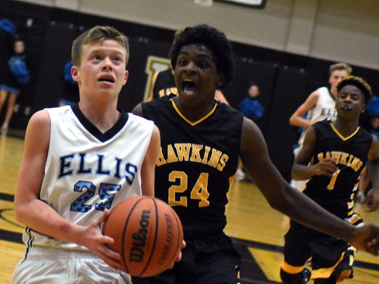 Ellis Middle's A.J. Owens drives to the basket under pressure from Hawkins' Brent Rowe during first-quarter action.