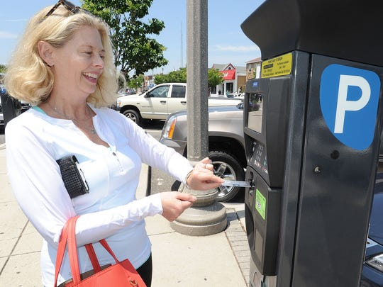 Nancy Lindsay from Crownsville, Maryland, pays for parking in Rehoboth Beach. New units now accept credit cards and the ParkMobile App.