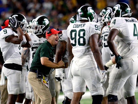Michigan State coach Mike Tressel tries to pump up