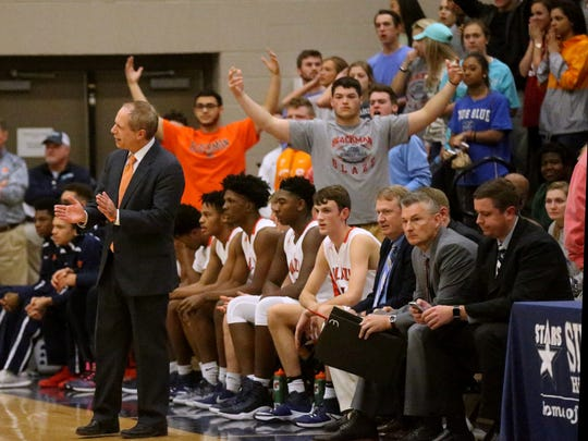 Blackman coach Barry Wortman instructs his team during the Region 4-AAA finals against Oakland.