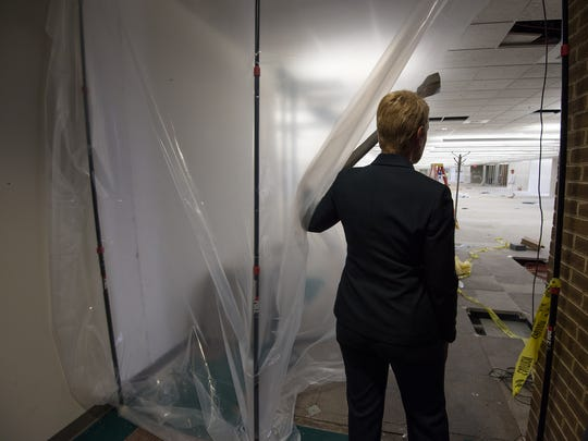 Transportation Secretary Jennifer Cohan looks at the renovations being performed at DelDOT'S headquarters in Dover.