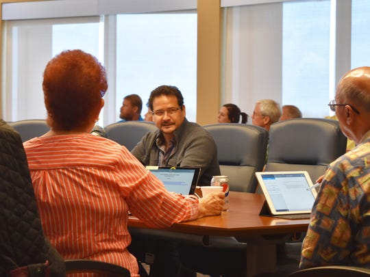Miguel Bordallo, Guam Waterworks Authority general manager, center, speaks with Guam Consolidated Commission on Utilities at a GWA work session on April 12, 2017.